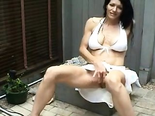 Athletic MILF masturbates coupled with squirts